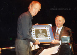 Centenial of British Film Commerative copy plaque being presented by Ron Curry to John Barry, Royal Albert Hall, Saturday 18th April, 1998.